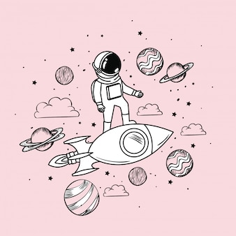 Космонавт рисует с ракетой и планетами