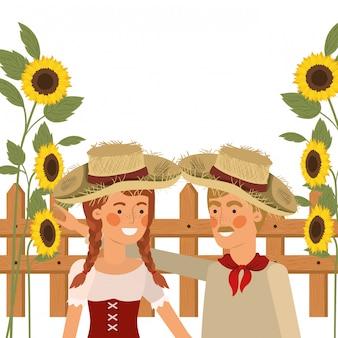 麦わら帽子と話している農民カップル