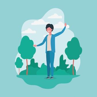 公園の文字で立っている若い男