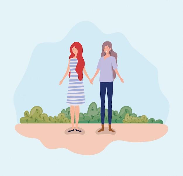 キャンプに立っている若いカップル女性