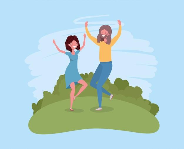 若いカップルが公園の文字で祝ってジャンプ