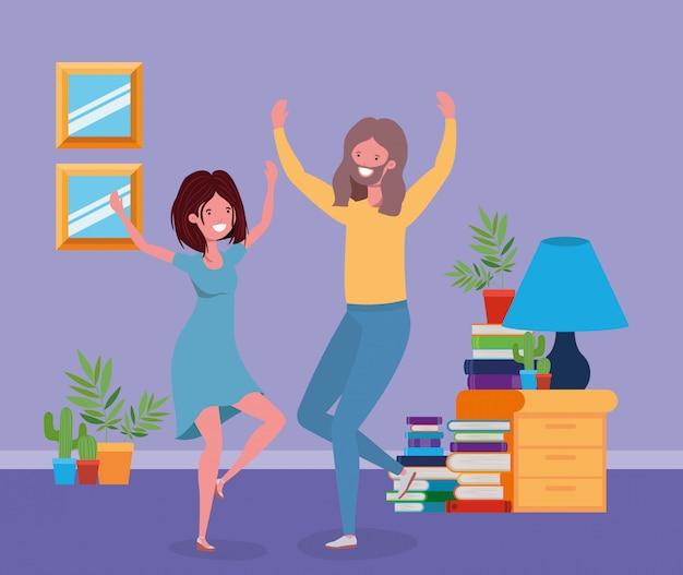 リビングルームで踊る若いカップル