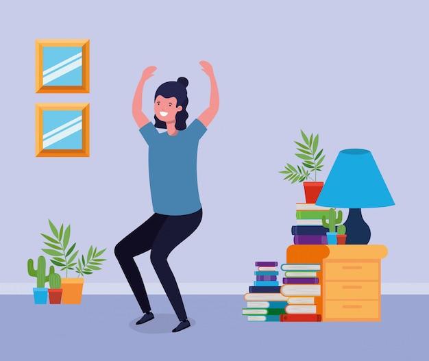 Молодой человек прыгает в гостиной