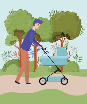 父は公園でカートで生まれたばかりの赤ちゃんの世話をして