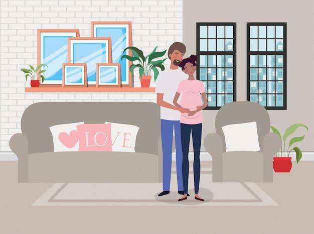 リビングルームのシーンで妊娠カップル