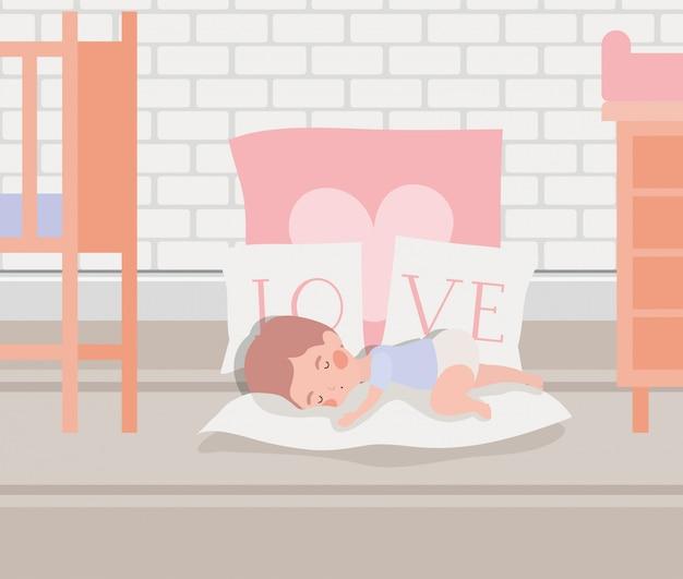 かわいいキャラクターを寝ている小さな男の子