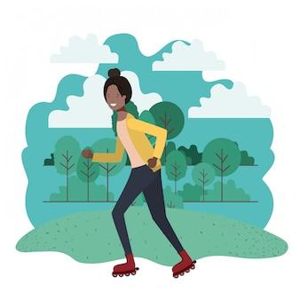 黒人女性が公園でスケートの練習