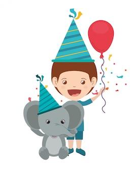 誕生日のお祝いに象を持つ少年