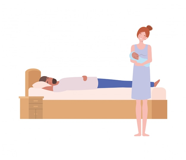 生まれたばかりの赤ちゃんとベッドで若いカップル