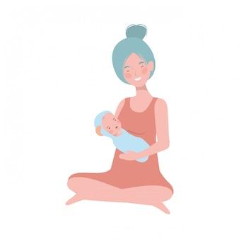 彼女の腕の中で生まれたばかりの赤ちゃんを持つ女性