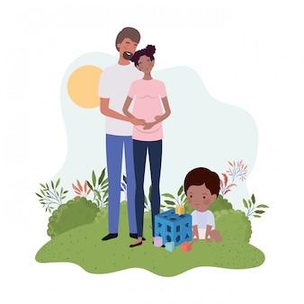 夫と赤ちゃんと妊娠中の女性