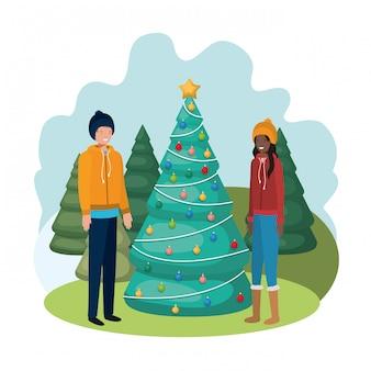 カップルは風景の中のクリスマスツリー
