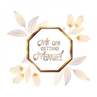 花とゴールデンフレームで結婚式の招待状