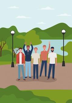 公園のキャラクターの異人種間の若い男性グループ
