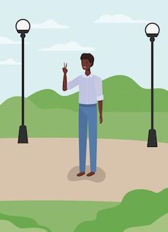 公園で若くてカジュアルなアフロ男