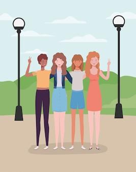 公園で若くて美しい女の子グループ