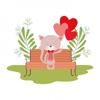 公園の椅子に座っているかわいい猫