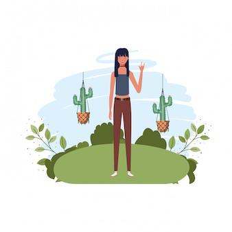 マクラメハンガーと風景を持つ女性