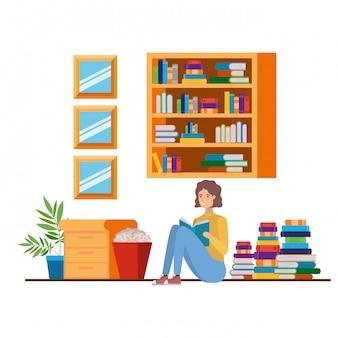 リビングルームで手に本を持つ男
