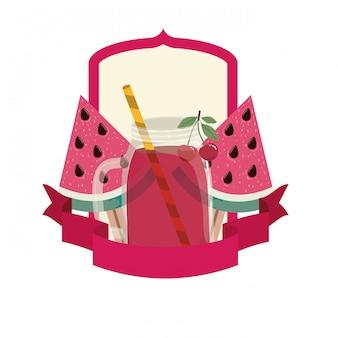 Стакан с арбузом и соломенным напитком