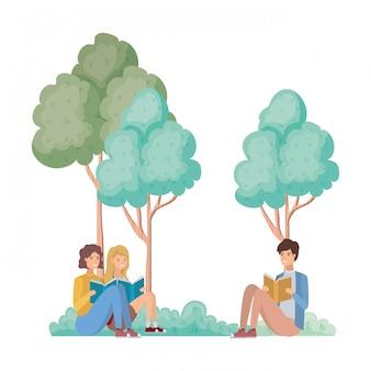風景の中の本で座っている人々のグループ