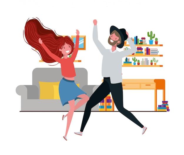 リビングルームの文字で踊る若いカップル