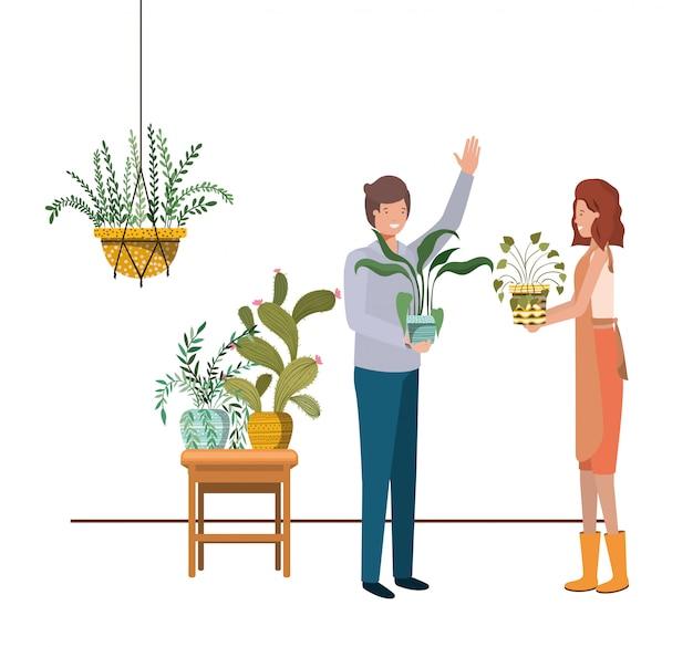 Пара с комнатным растением на вешалках