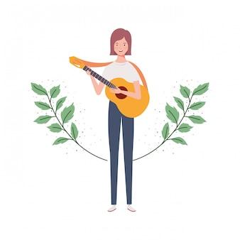 アコースティックギターと枝と葉を持つ女性