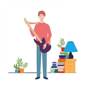 リビングルームでエレキギターと若い男