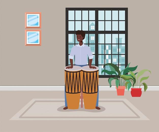 ボンゴスキャラクターを演奏するアフロ男