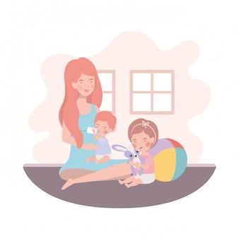部屋に小さな子供たちとかわいい妊娠母親