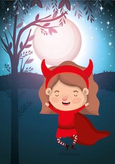 女の子の衣装の悪魔とハロウィーンシーズンシーン