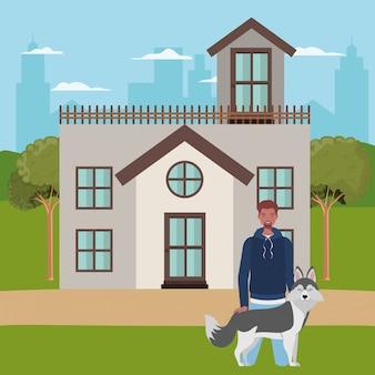 屋外の家でかわいい犬のマスコットを持つアフロ男