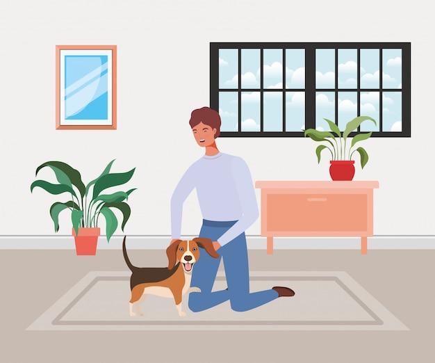 Молодой человек с милой собакой талисман в комнате дома