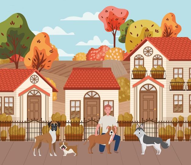 秋の街のシーンでかわいい犬マスコットと若い男