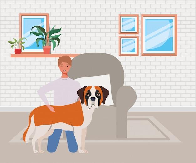 リビングルームでかわいい犬のマスコットと若い男