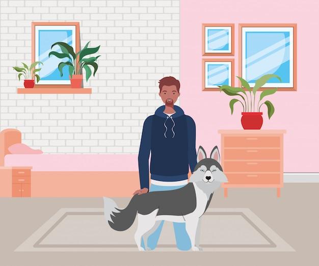 寝室でかわいい犬のマスコットとアフロの男