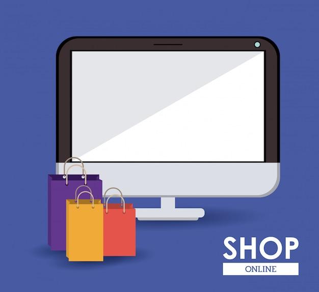 ショップオンラインコンセプト、買い物袋を持つコンピューター