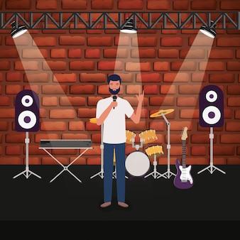 コンサートステージでマイクを使って歌う男