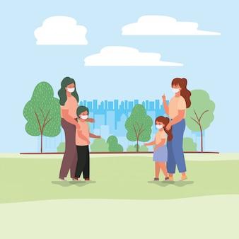 母親と子供たちは公園の設計でマスクを
