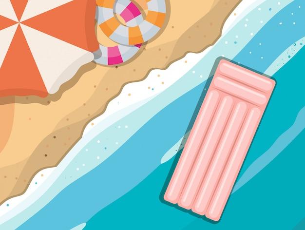 Пляж с зонтиком и поплавками, вид сверху, летние каникулы