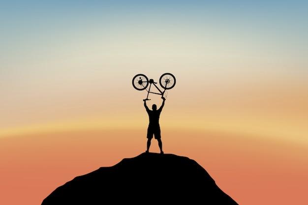 山の頂上のサイクリスト