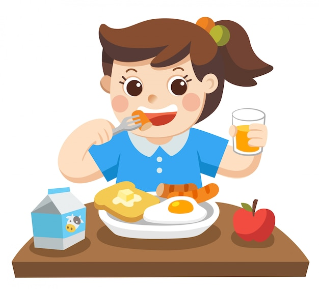 朝の朝食を食べて幸せな女の子。