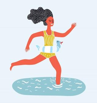 海水図に立っている黄色のビキニでスリムで魅力的な若い女性