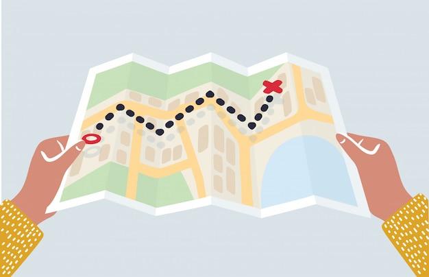 紙の地図を保持している手。男性の手で折り畳まれた地図。観光客は市内の地図を川に見て探しています。フラットなデザインのイラスト。旅行の概念。