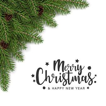 モミの枝の装飾とメリークリスマスのグリーティングカード