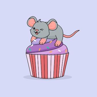 Симпатичная мышь на фиолетовом кексе
