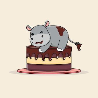 Милый бегемот на вершине торта
