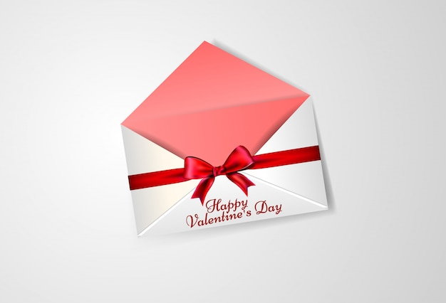 バレンタインデーのための弓を持つ白い封筒