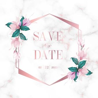 結婚式のモノグラムのロゴと招待カードの大理石の背景に花模様のローズゴールドの幾何学的なフレーム